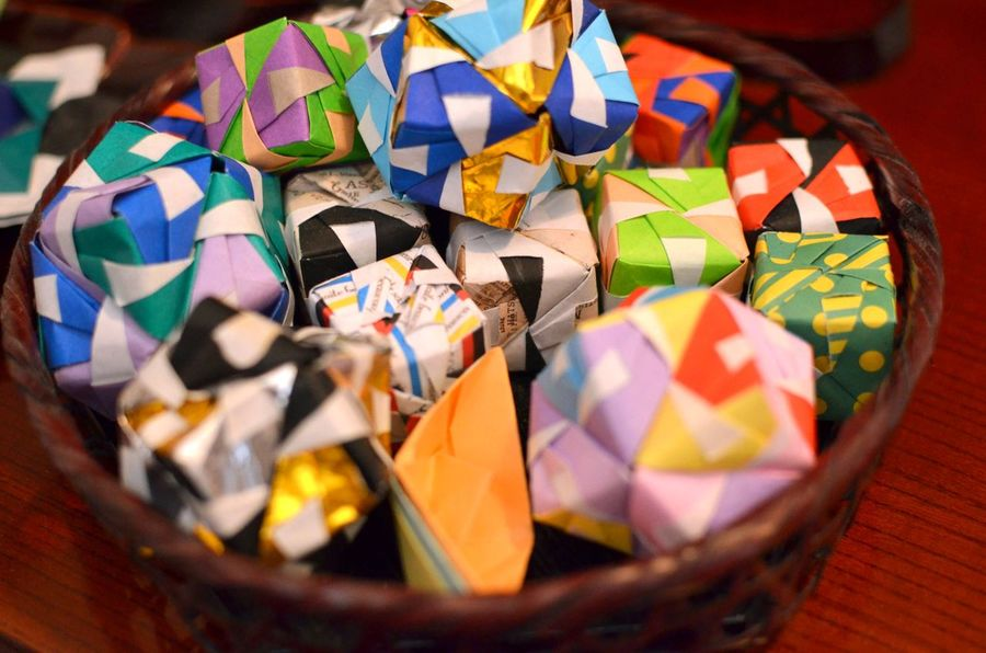 a basket of origami shapes and forms made of vibrant multi-colored paper. Origami Paper No People Japanese Art Multi Colored Close-up