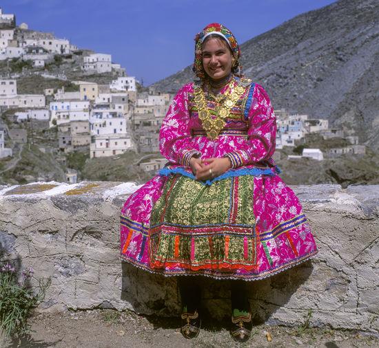 Portrait of smiling woman against building