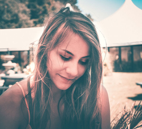 EyeEm Best Shots Beautiful Woman Beauty Close-up Contemplation Focus On Foreground Front View Hair Hairstyle Headshot Leisure Activity Lifestyles Long Hair Looking Looking Down Nature One Person Outdoors Portrait Real People Young Adult Young Women