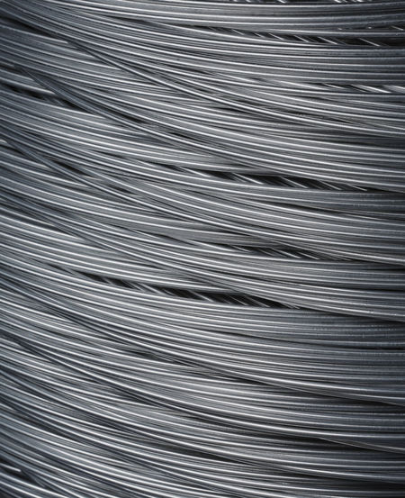 A Roll of steel wire in closeup. Full Frame Backgrounds Pattern Silver Colored No People Metal Still Life Repetition Wireless Technology Metal Wire Steel