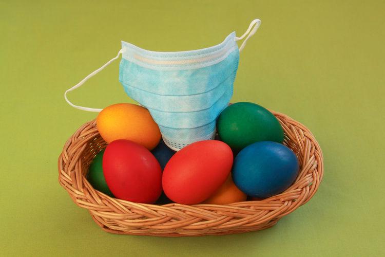 Multi colored eggs in basket