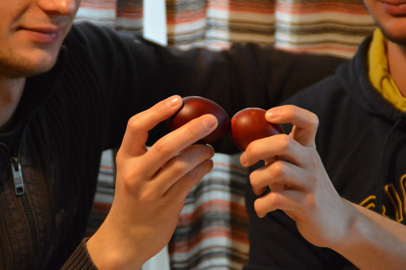 Midsection Of Men Playing Holding Easter Eggs