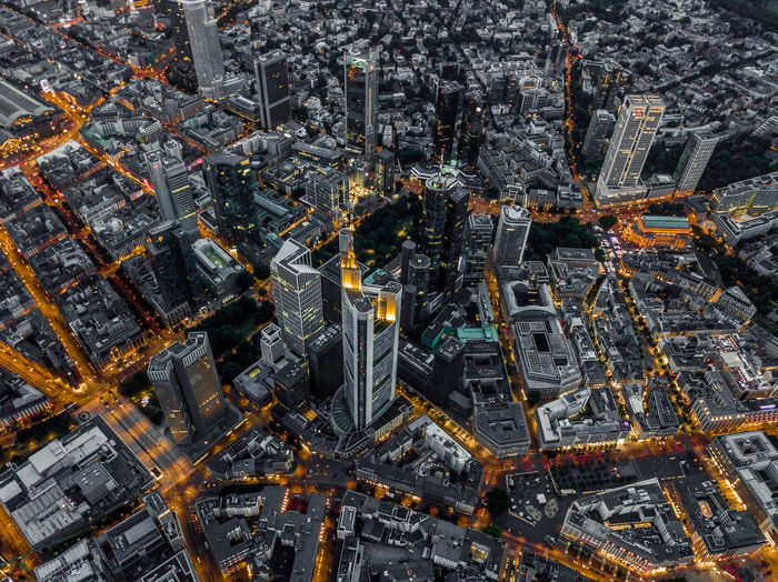 Aerial overhead shot of frankfurt am main, germany skyline at night with glowing streets