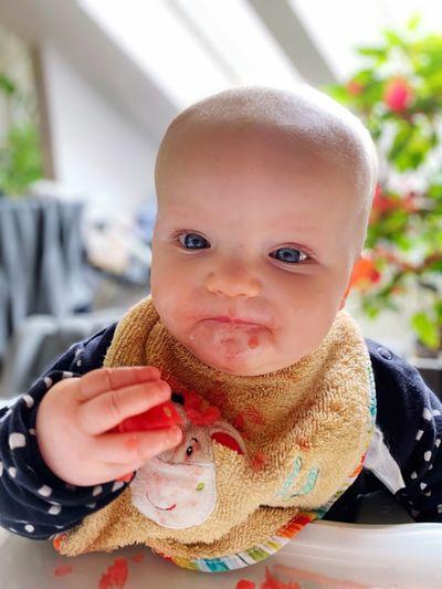 Portrait of cute baby girl eating food