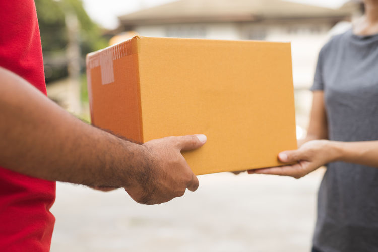 Close-up of man working in box