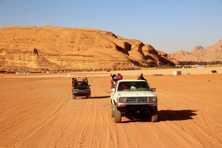 Tractor in desert against sky