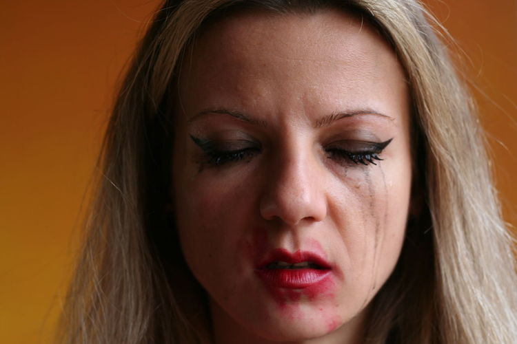 Close-up of sad woman with messy make-up