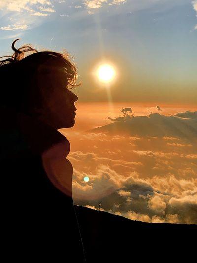 Hiker against sky during sunset