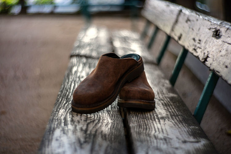 High angle view of shoes on bench
