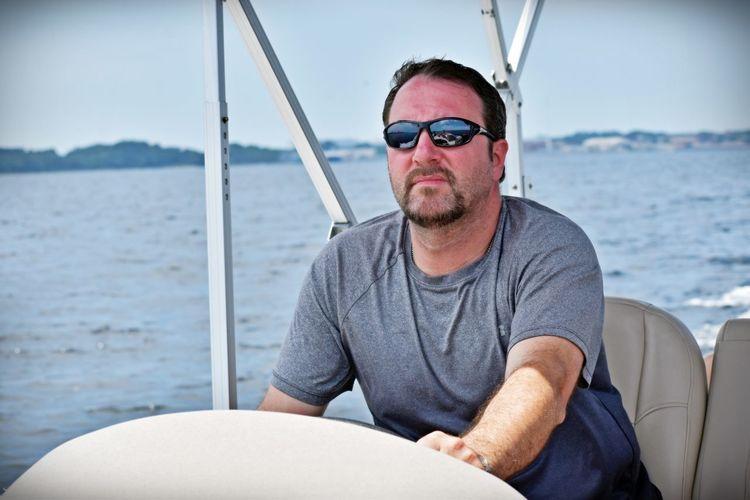 Man sitting on sailboat in sea