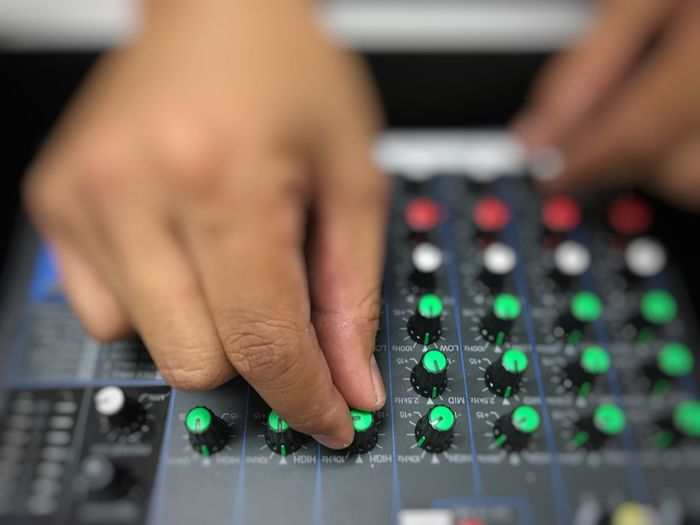 Close-up of person playing sound mixer