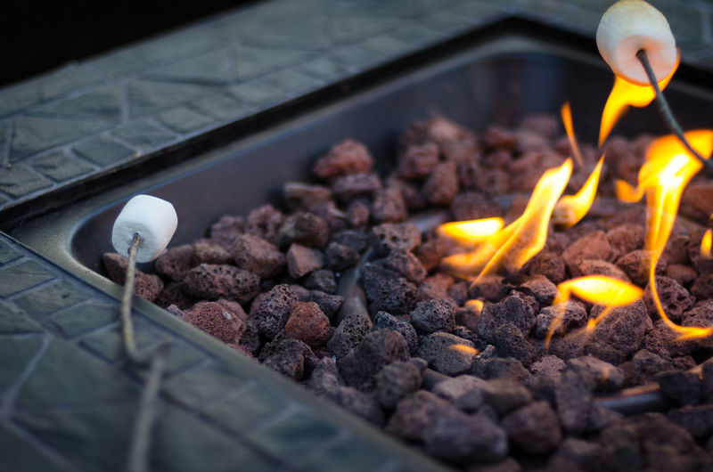 Close-up of marshmallows by fire pit