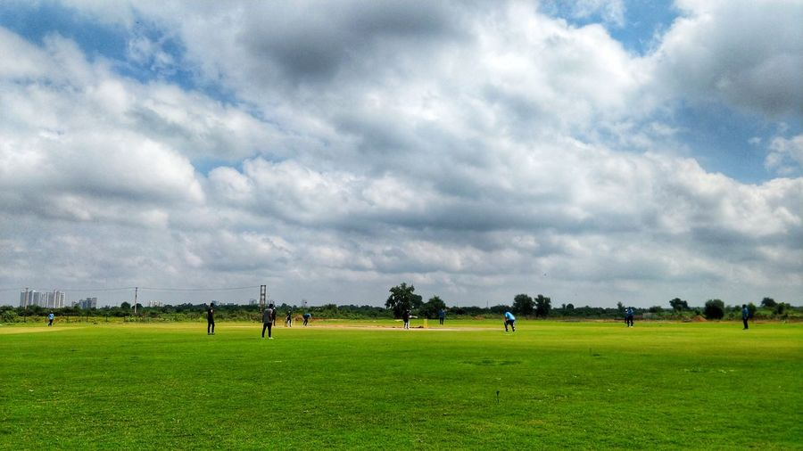 Cricket Ground Gurgaon Cricket Field #clouds  Newdelhi DelhiNCR Sky And Clouds #cricketlight #cricketground EyeEm Selects #photography #gurgaon Sport Sports Clothing Playing Field Competition Field Soccer Field Soccer Grass Sky Landscape
