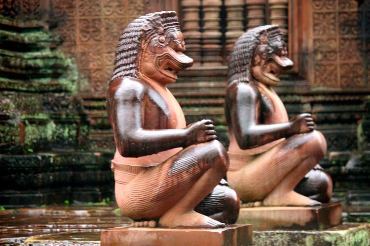 Art Art And Craft Cambodia Casual Clothing Creativity Cultures Focus On Foreground Front View Human Representation Ornate Portrait Real People Religion Sculpture Siem Reap Sitting Statue