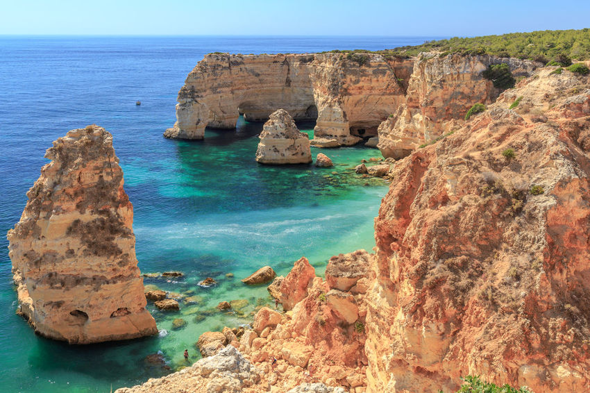 One of the worlds most beautiful beach, the Praia da Marihna at the Portuguese Algarve Coast Rock Rock - Object Sea Water Solid Rock Formation Scenics - Nature Beauty In Nature Tranquil Scene Land Cliff Tranquility Nature Sky Horizon Over Water Idyllic No People Day Natural Arch Outdoors Rocky Coastline Caramujeira Praia Da Marinha Algarve Algarve, Portugal