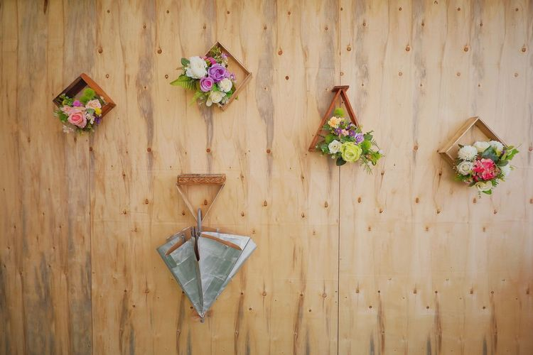 Colorful artificial flowers decorations and geometric wooden frame hanging on wood planks wall background in home interior decoration design concept Design Square Bunch Bouquet Fresh Style Space Detail Objects Architecture Artificial Flower Decoration Interior Wooden Wall Pattern Frame Vintage Umbella Multi Colored Hanging Wood - Material Flower Arrangement Bunch Of Flowers Colorful Architectural Detail