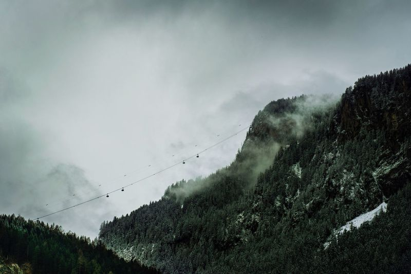 Tiroler Alpen Sky Low Angle View Outdoors Power Line  Cable No People Connection Nature Scenics Mountain Beauty In Nature Landscape Alps Trees Cloudy Fog Foggy EyeEm Best Shots EyeEmNewHere EyeEmBestPics Woods Glacier Mountain Peak Gondola Lost In The Landscape