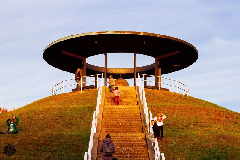 Low angle view of people on staircase at fly mountain lilienthal park