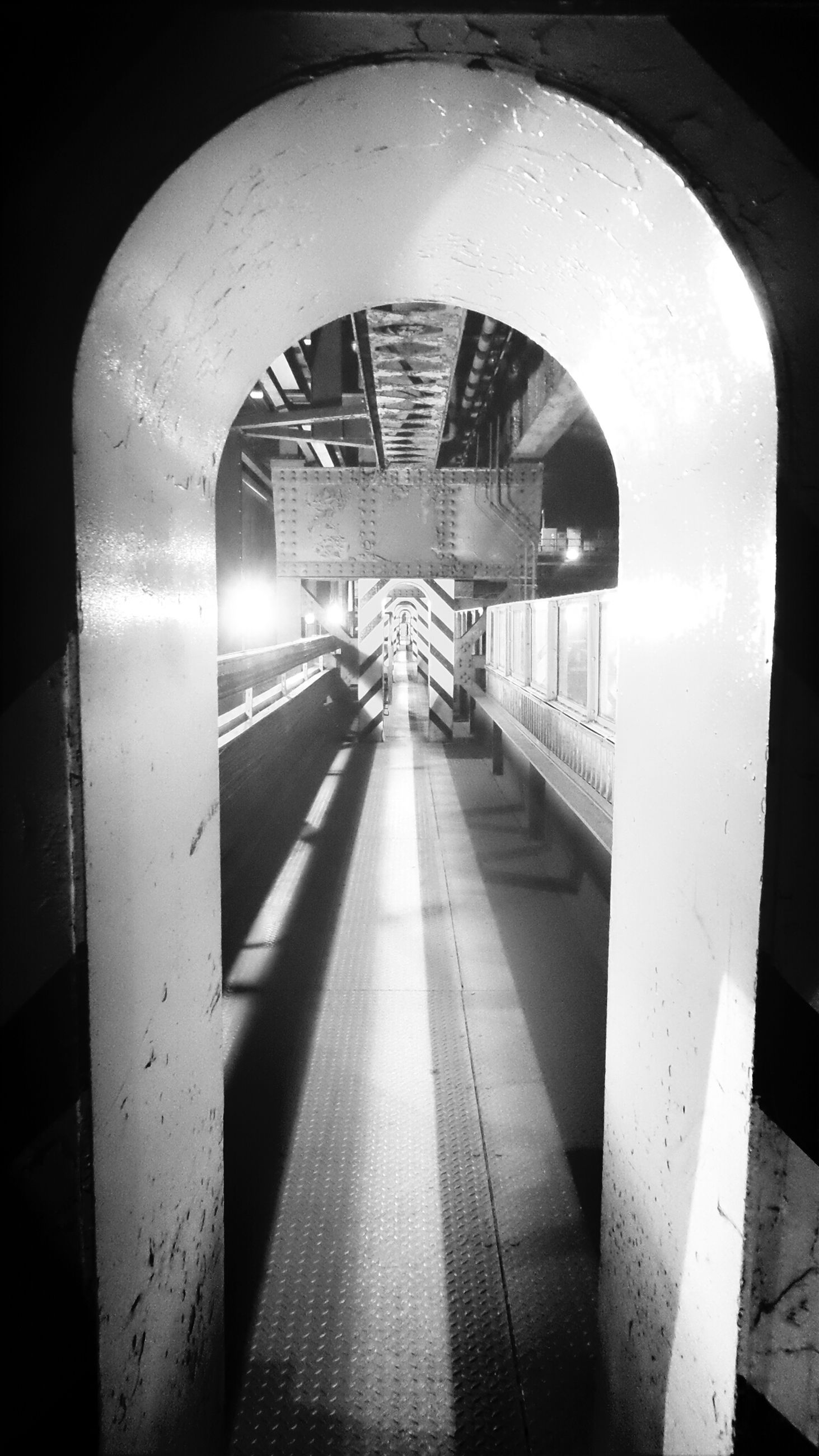 indoors, the way forward, architecture, built structure, tunnel, diminishing perspective, transportation, illuminated, ceiling, vanishing point, empty, railroad station, railing, arch, rail transportation, railroad station platform, subway, railroad track, incidental people, walkway
