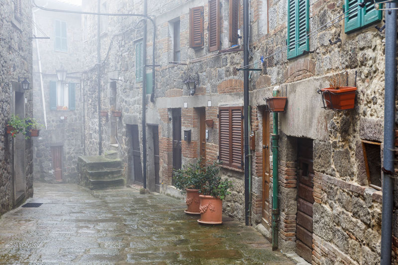 Misty alley in an Italian village City Dark Misty Rain Retro Abbadia San Salvatore Alley Alleyway Architecture Building Exterior Built Structure Day Fog Foggy Italy Mist Mysterious No People Outdoors Rainy Street Town Urban Village Waether