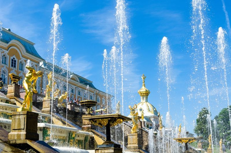 The Grand Cascade of the Peterhof Palace in Petergof, St Petersburg, Russia St Petersburg St Peterburg Petergof Palace Grand Cascade Petergof Gilded Sculptures Sculpture Gold Golden Statues Palace Tsarist Russian Sankt-Petersburg Sankt Petersburg Saint Peterburg Saint Petersburg Fountains Golden Statue Baroque Architecture Baroque Baroque Style Architecture Built Structure Architecture Sky Building Exterior Ornate Tourism