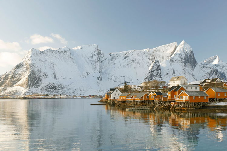 yellow rorbuers-lofoten Mountain Water Cold Temperature Sky Winter Beauty In Nature Scenics - Nature Snow Architecture Built Structure Building Waterfront House Building Exterior Reflection Nature Snowcapped Mountain Day Mountain Range No People Outdoors Lofoten Norway Ice Winter