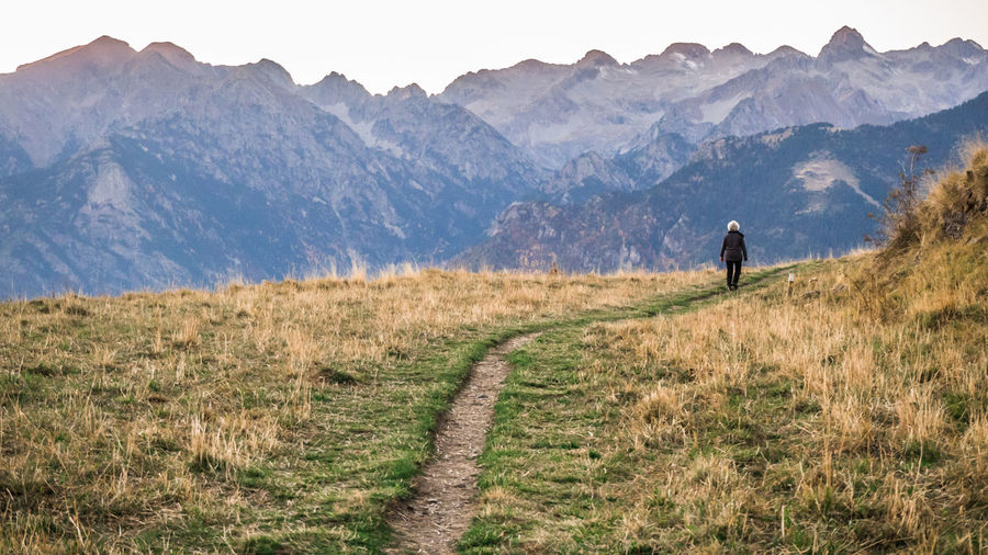 Beauty In Nature Day Full Length Hiking Landscape Leisure Activity Men Mountain Mountain Range Nature One Man Only Outdoors Path Pathway People Silhouette Sky Walking