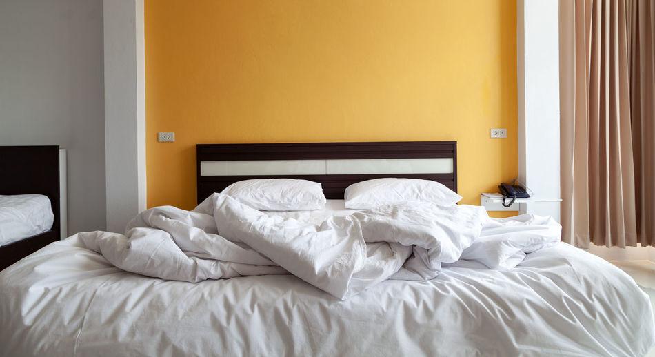 Empty bed in bedroom