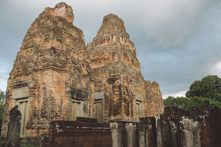 Siem Reap Cambodia Angkor Built Structure Architecture History The Past Building Sky Religion Place Of Worship Building Exterior Belief Spirituality Old Ancient Low Angle View Travel Destinations No People Tourism Travel Cloud - Sky Outdoors Ancient Civilization Archaeology Ruined