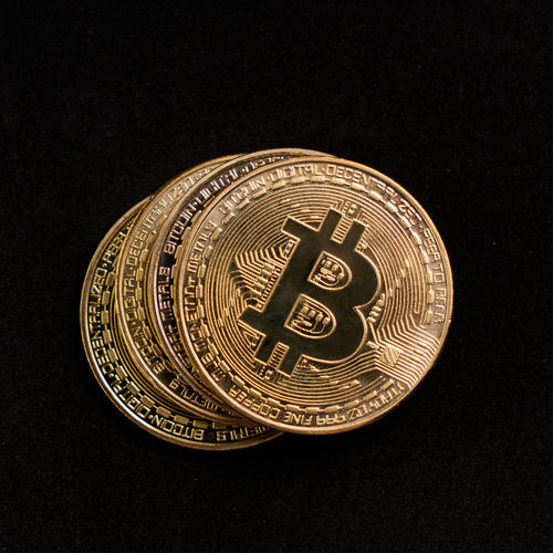 Bitcoins on a clean black background Black Background Studio Shot Still Life Close-up Finance Metal Economy Single Object Bitcoin Cryptocurrency Crypto Currency Coins Digital Currency Isolated Background Dark Copy Space Currency Gold Coins Gold Business Economy Finance And Economy