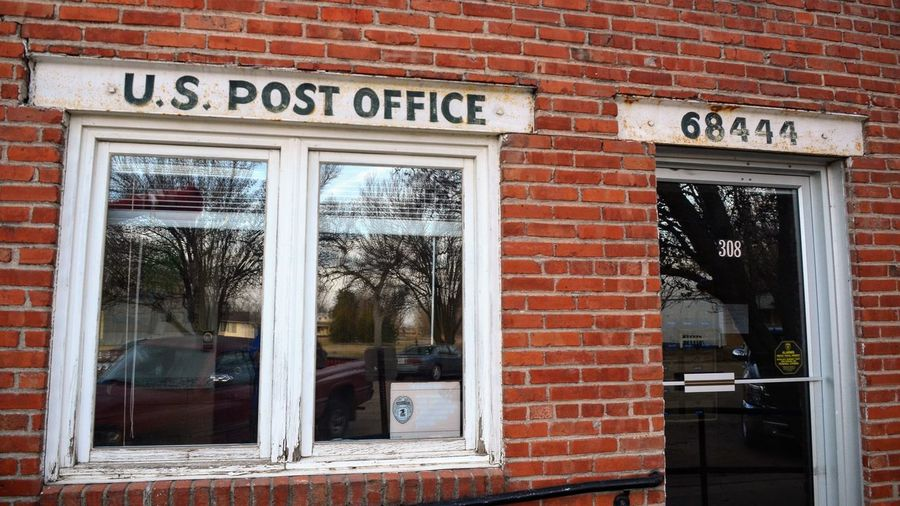 Visual Journal February 2017 Village of Strang population 29, Fillmore County, Nebraska A Day In The Life Architecture Brick Building Building Exterior Built Structure Everyday Lives EyeEm Best Shots EyeEm Gallery Getty Images Historical Building No People Old Buildings Old West  Old Western Town Outdoors Photo Diary Post Office Reflection Rural America Rural Life Small Town Storytelling Visual Journal Window Zip Code Tour