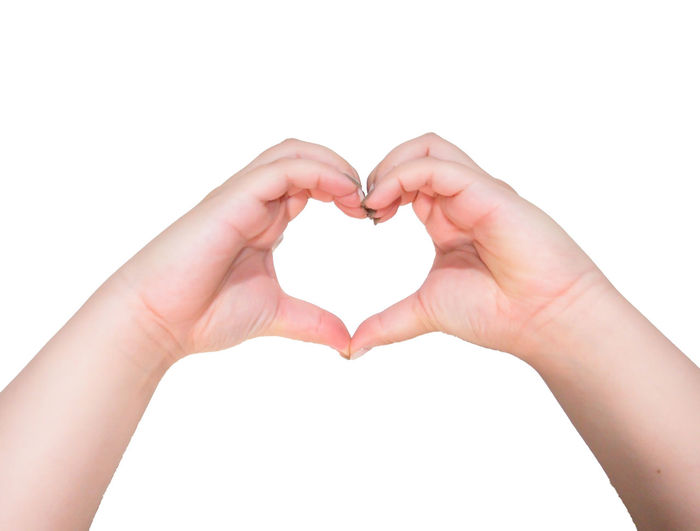 Hands do a heart shape against white background Human Hand White Background Studio Shot Human Finger Close-up Symbol Gesturing Isolated White Background Sign Concept Communication Heart Shape Love Positive Emotion Women Hole Like Letter Give Flirting Happy Relationship Cute