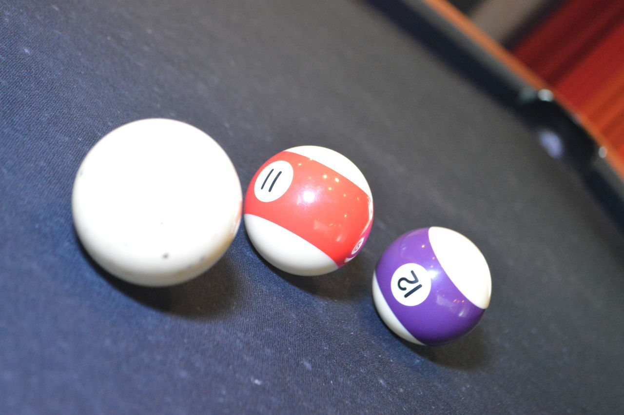 number, pool ball, table, sport, still life, high angle view, pool - cue sport, pool table, indoors, leisure games, snooker, snooker ball, communication, close-up, no people, pool cue, day