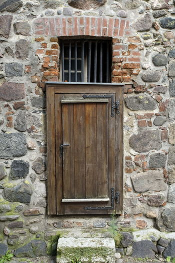 Architecture Brick Wall Building Exterior Built Structure Close-up Closed Day Door Historic No People Outdoors Prison Stone Wall Wood - Material