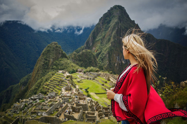 Woman standing against mountains