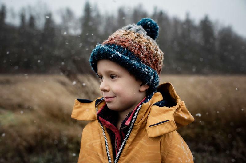 Portrait of boy looking away in snow