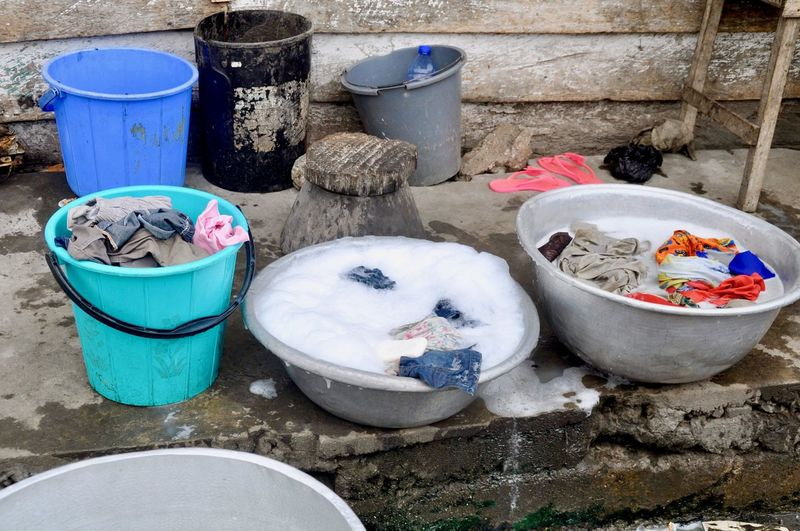 Wash By Hand Doing The Laundry Container No People Bucket Day Bowl Outdoors High Angle View Still Life Wall - Building Feature Household Equipment Close-up Wall Group Of Objects Laundry Laundry Day Africa Ghana Basin Foam Poverty Social Issue Water Multi Colored