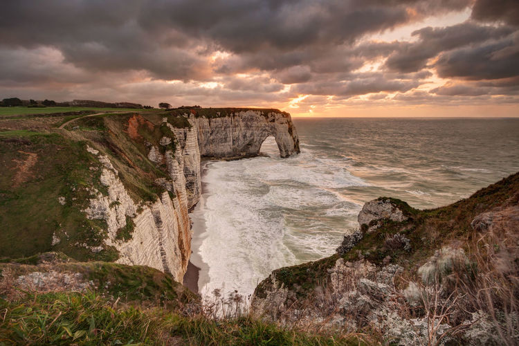 Etretat, France, at sunset étretat Etretat Cliffs France Natural Arch Arch Sunset Storm Ocean Sea Travel Destinations Normandie Nature Landmarks Landscape Waves Sky Water Cloud - Sky Scenics - Nature Beauty In Nature Cliff No People Outdoors