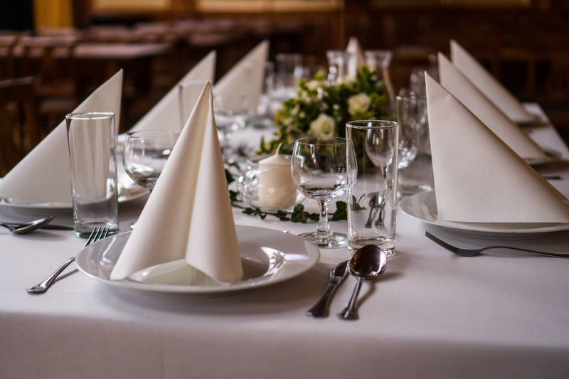Place setting on table at restaurant