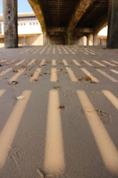 Built Structure Architecture Transportation No People Nature Bridge Shadow Day Sunlight Surface Level Connection Bridge - Man Made Structure Beach Outdoors Sand Diminishing Perspective The Way Forward Direction Road Architectural Column