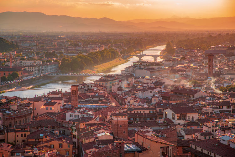 Panoramic overview from arnolfo tower  - torre di arnolfo at sunset haze.