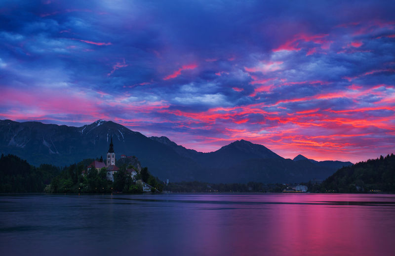 Springtime in Slovenia. Beauty Bled Church Clouds Cloudy Dramatic Sky Europe First Light Island Lake Landscape Morning Mountain Nature Outdoors Red Sky In The Morning Sky Slovenia Springtime Sunrise Sunset Tourism Travel Travel Destinations Water