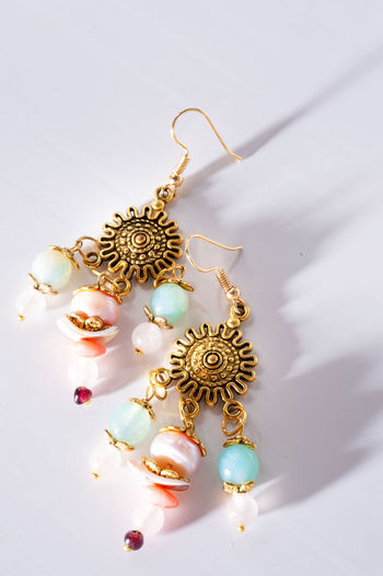 High angle view of earrings on table