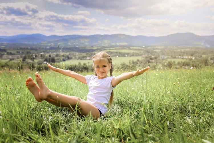 Full length of cute girl on field