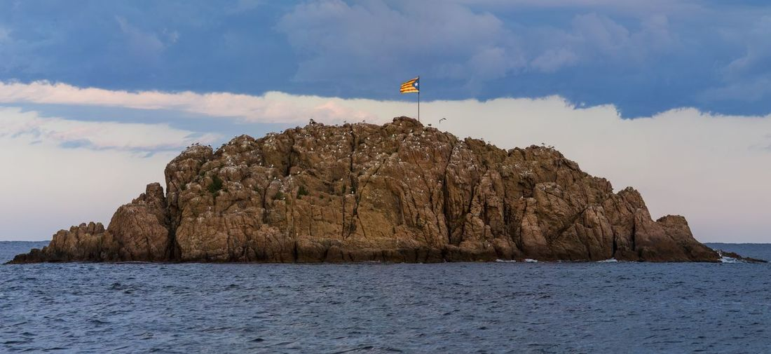 ‎Estelada Blava, Flag of Catalan. Panorama shot of flag flying in Tossa de Mar. Cloud - Sky Sky Politics And Government Catalonia Lone Star Flag Estel Independence Referendum Current Affairs News Architecture Scenics Landscape Day People The Week On EyeEm Check This Out Outdoors Paint The Town Yellow Panorama Seascape Catalan The Week On Eyem Lost In The Landscape