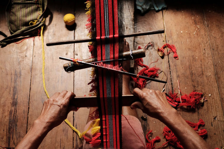 High Angle View Of Person Doing Traditional Weaving