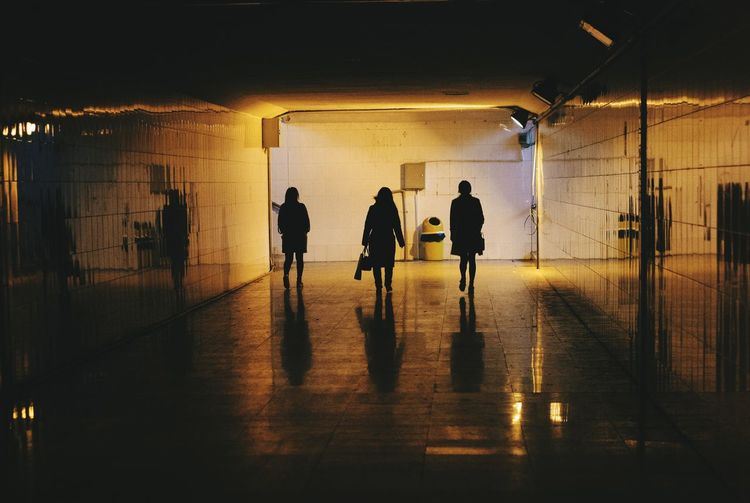Silhouette Women Walking In Subway