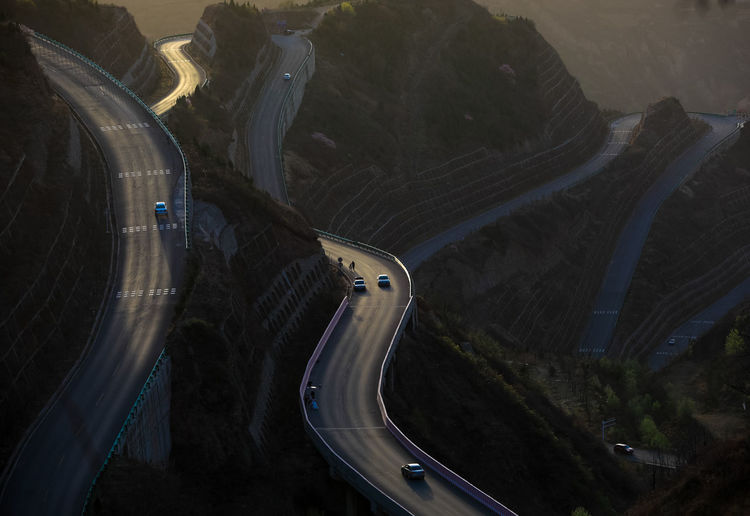 Transportation Road High Angle View Mode Of Transportation Car Motor Vehicle Land Vehicle Highway Mountain Nature Mountain Road No People Curve Travel Day Outdoors Plant Architecture Street Environment Multiple Lane Highway