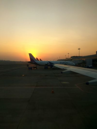 Sunset Airplane Airport Travel Transportation Airport Runway No People Aerospace Industry Outdoors Air Vehicle Day Wings Shades Of Sky Yellowsky Time To Fly Mumbai Airport