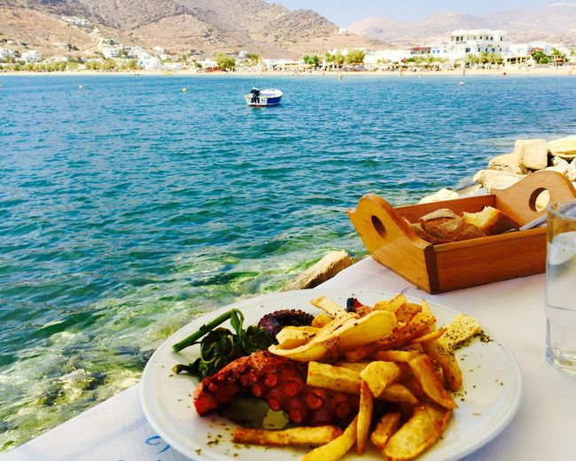 Perfect Lunch in the Sea of Ios Greece , Greece Sea View Sea Landscape Landscape Pornfood Octopus Fish Potatoes Food Sun Lay the Table Color Of Life New Talent